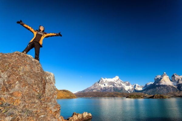 Person on edge of rock in Torres del Paine
